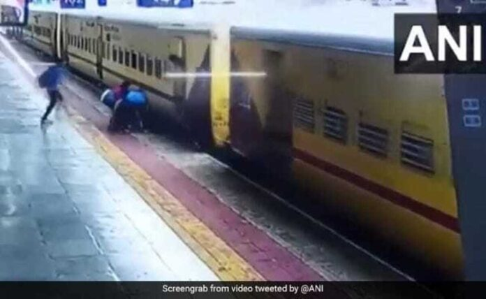 Woman trying to board a moving train slips, saved by passengers