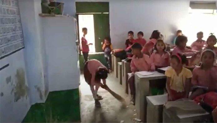 Children are doing brooms in Primary School of Rawal Hardoi